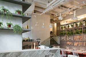 Greenery, wood, brass and rustic design at Grassroots Pantry