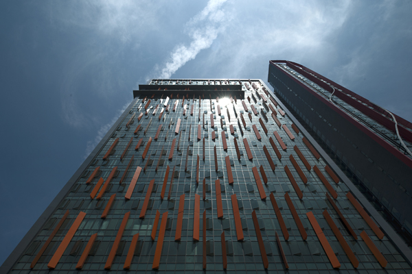 The hotel, for example, is identified by a series of orange fins on its facade