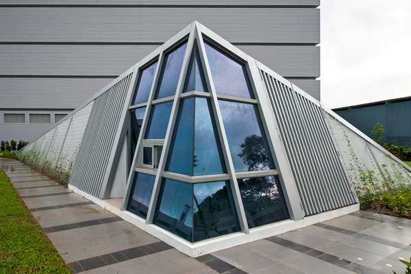 12-Stylish-guardhouse,-aligned-with-the-angular-aesthetic-of-the-project,-integrated-with-green-roof-and-creepers