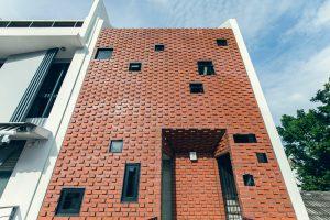 Yuk Tong Avenue House by MAKK Architects facade 3