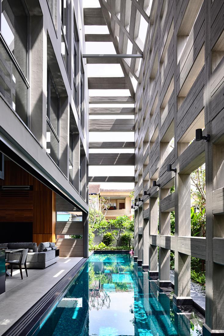 HYLA-Concrete-light-house-framework-over-pool