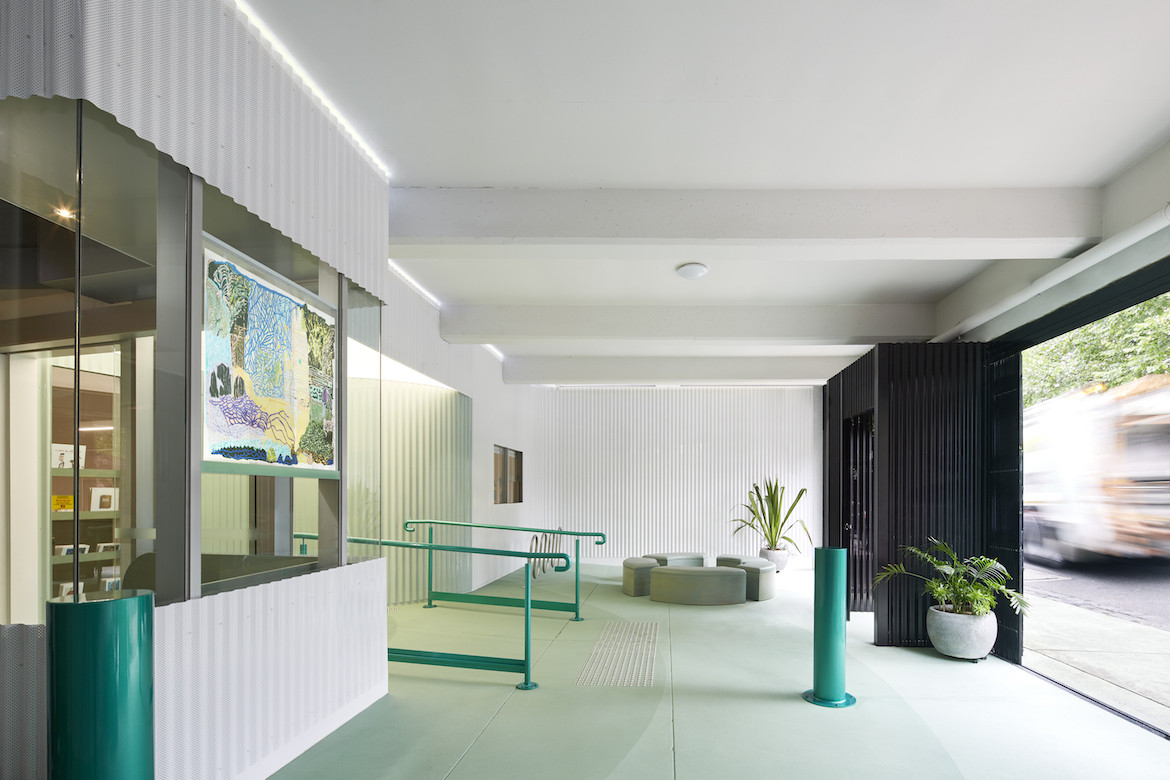 APA's green and white entrance area, designed by Sibling Architects.