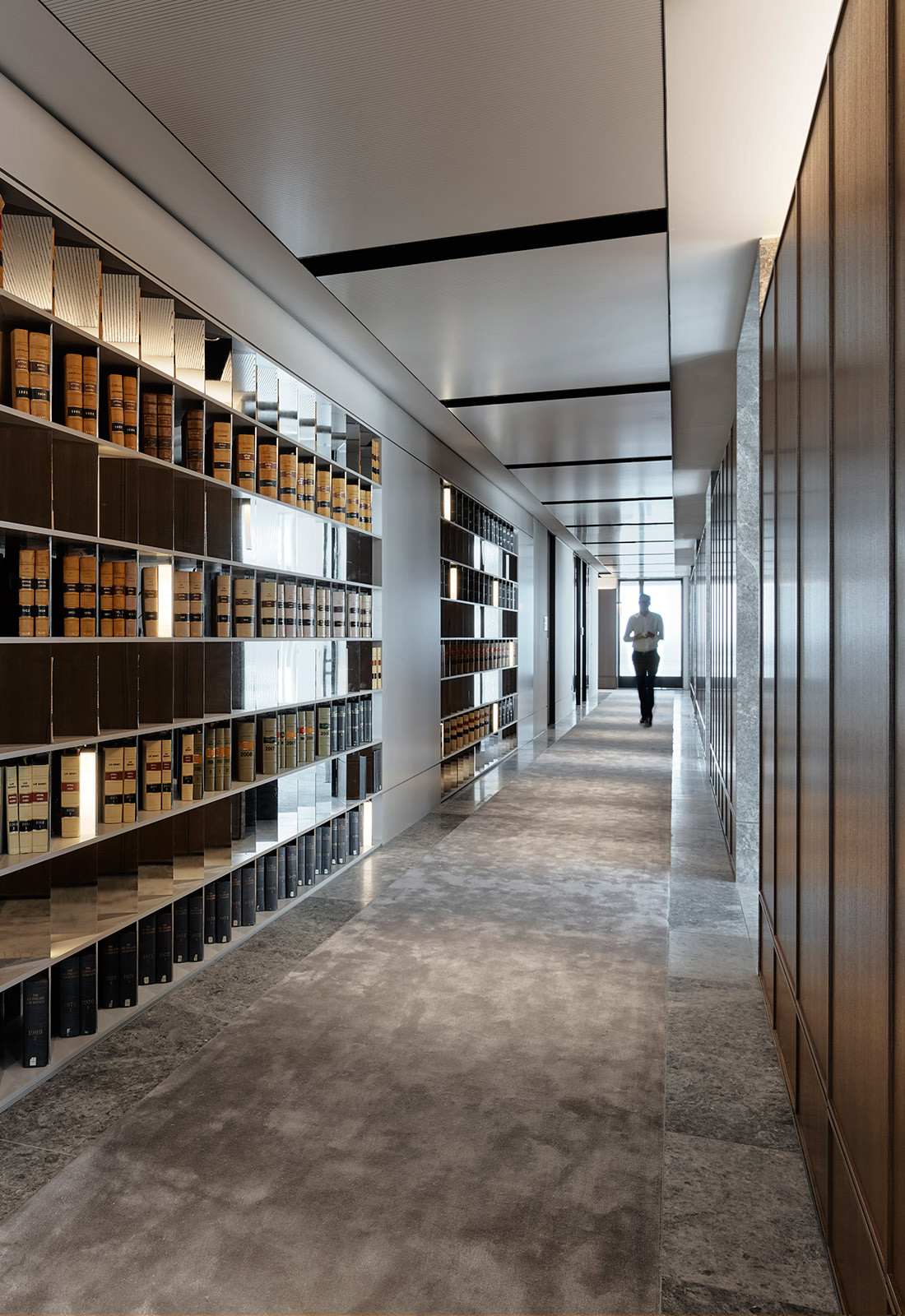 Bookcase lined corridor in Banco Chambers Martin Place office fitout, designed by Bates Smart