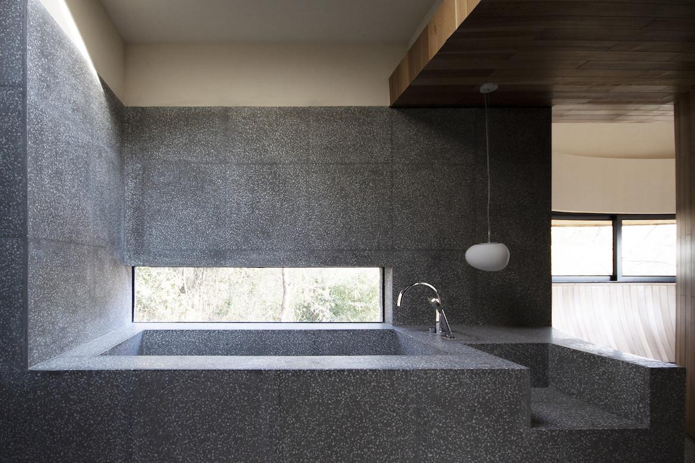 The ash-grey bathtub with a small window beside it in The Mushroom by ZJJZ