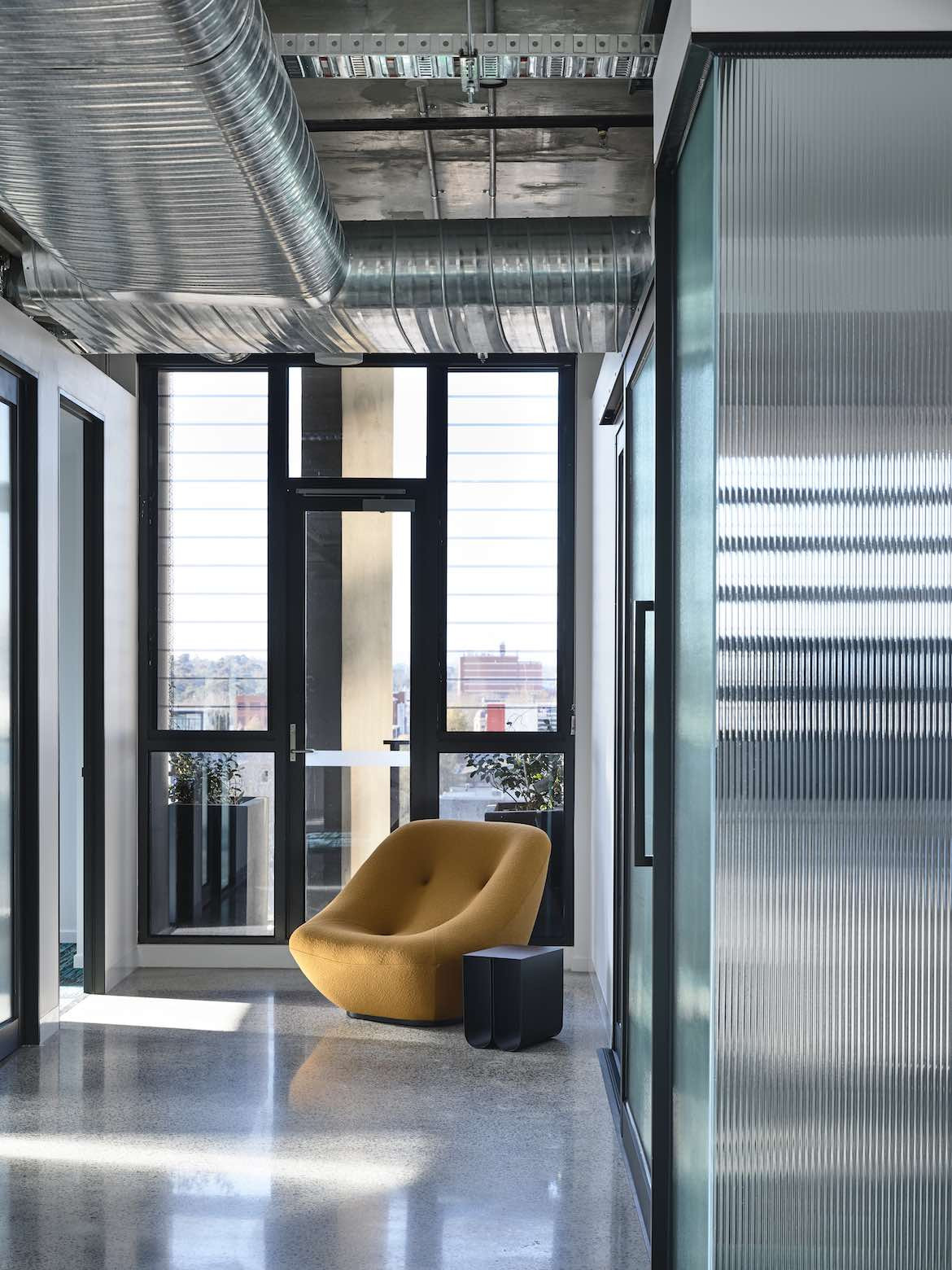 Interior yellow chair in the McCluskey Studio and SJB designed medical practice.