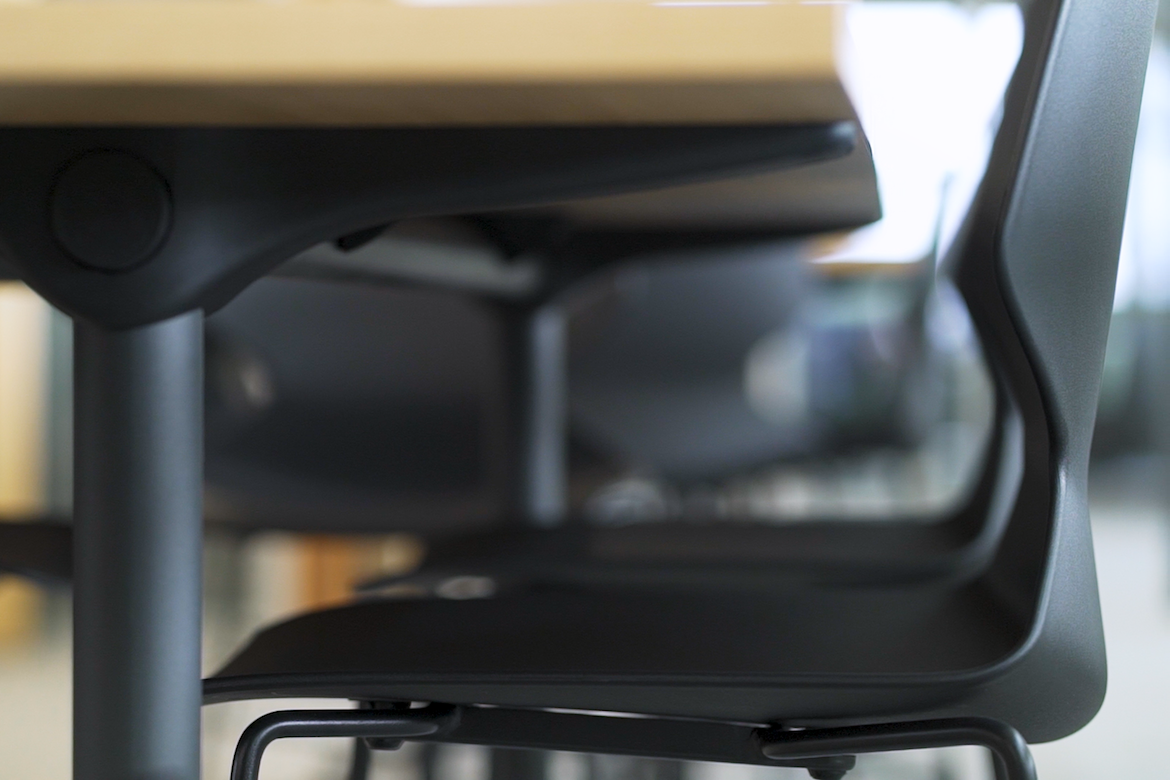 A close up of Buro's black Konfurb Fly Sled Chairs.