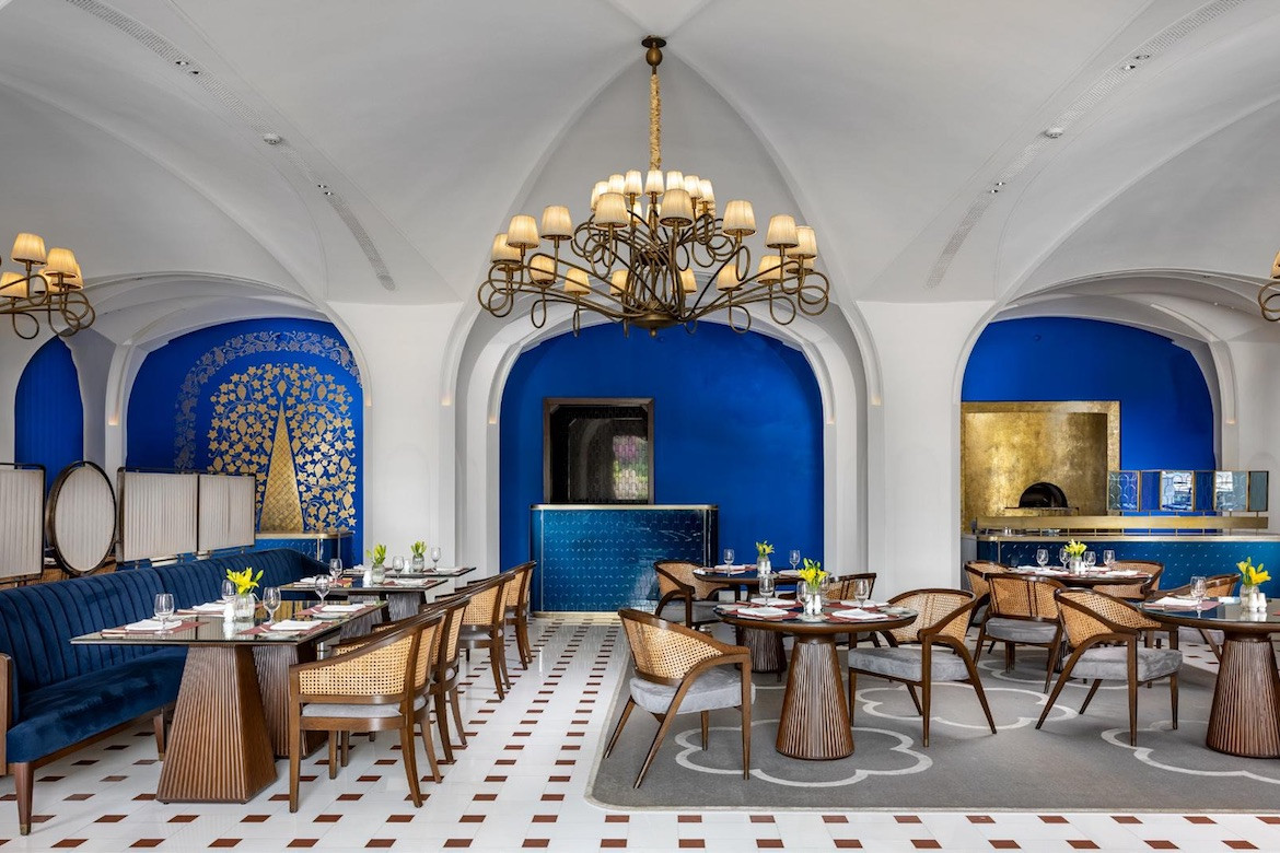 Blue, white and brown interiors at Bellevue at The Oberoi