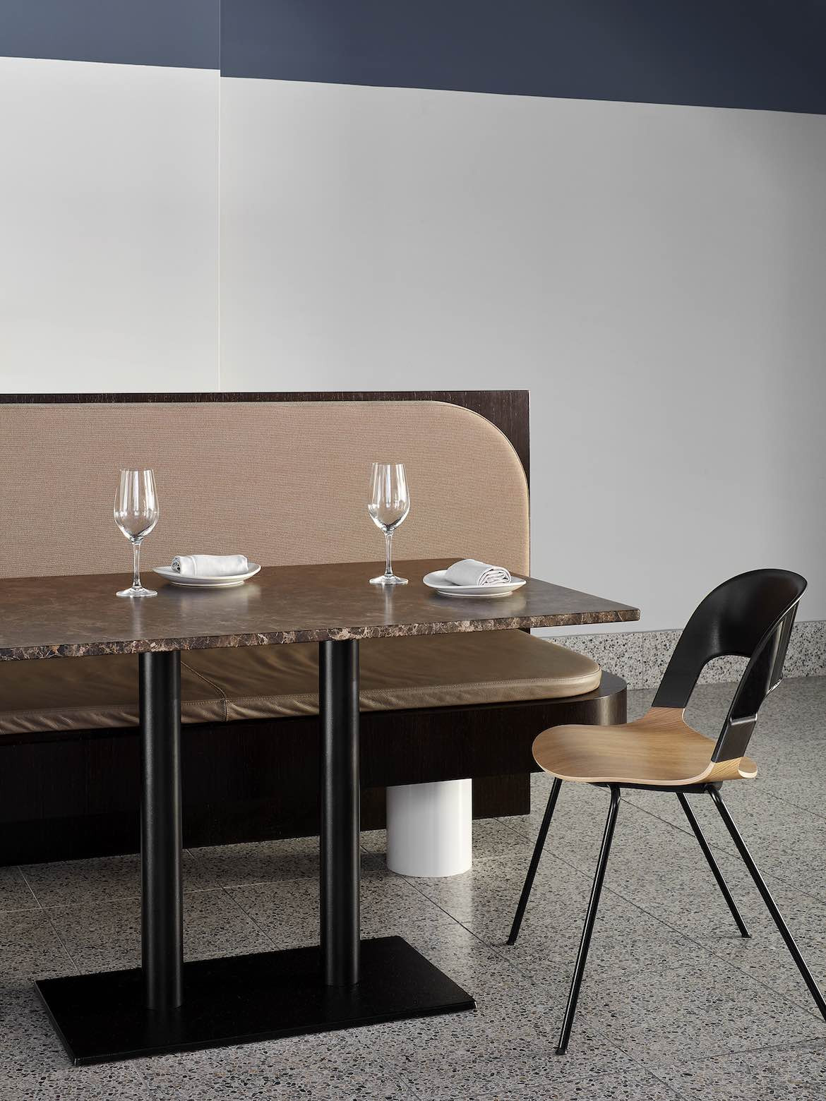 Table, chair and benchseat in the Stables Bar by State of Kin.