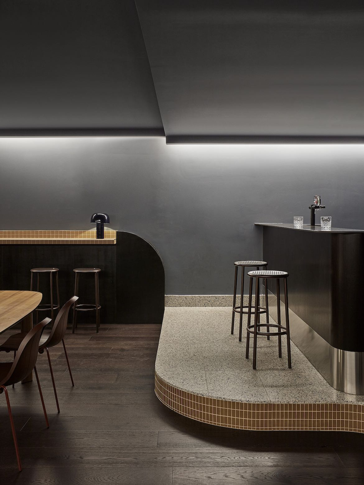 Blue wall and terrazzo floor in the Stables Bar by State of Kin.