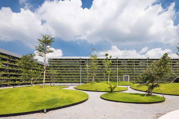 Industrial architecture meets sustainable design in Jakob Factory Saigon, in Ho Chi Minh City, Vietnam, by Rollimarchini Architekten and G8A Architects.