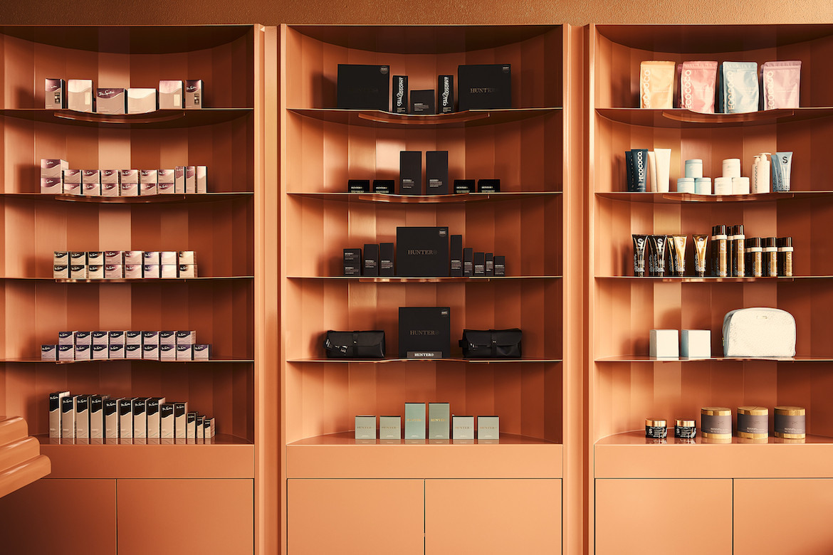 Products on the monochromatic shelves of Beauty Block.