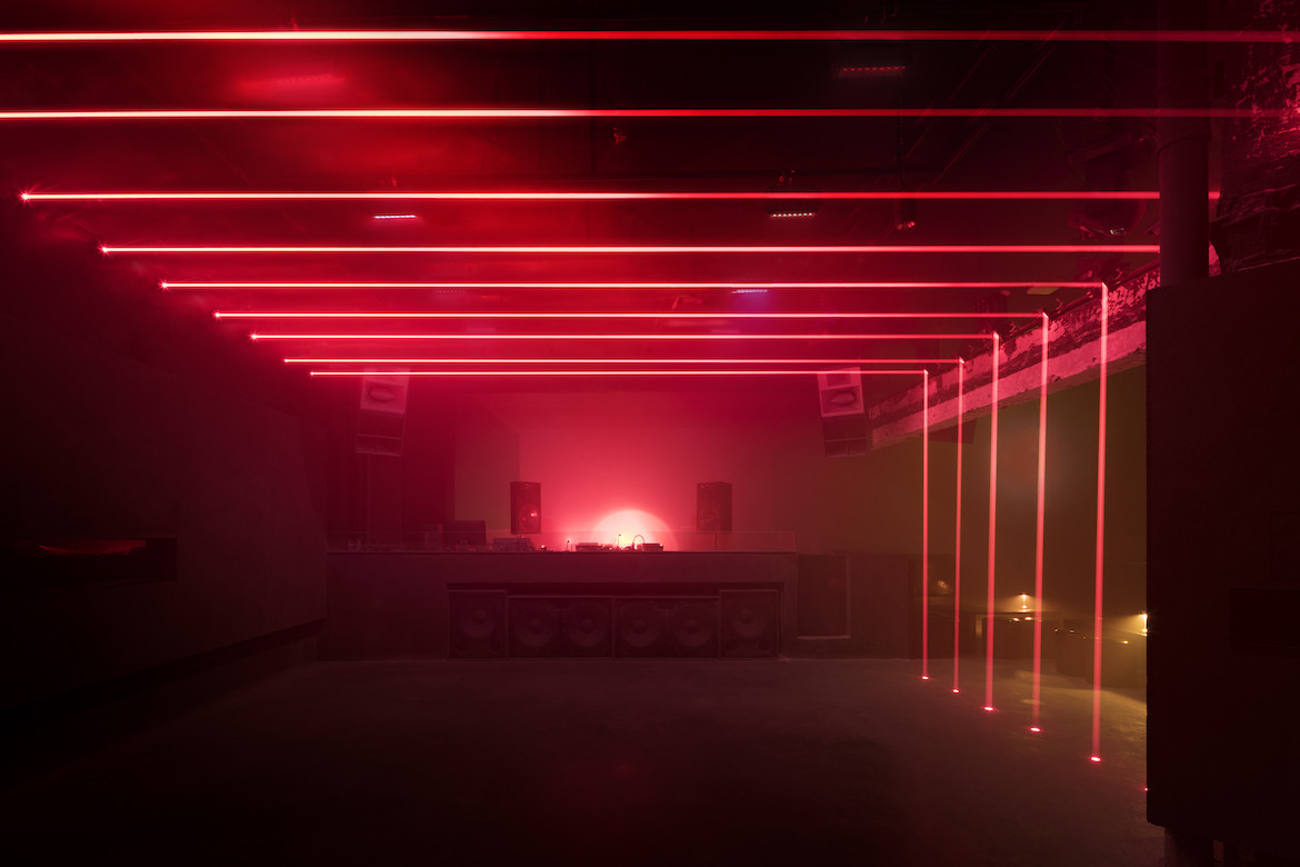 Red lasers create a geometric outline of the club's dancefloor.