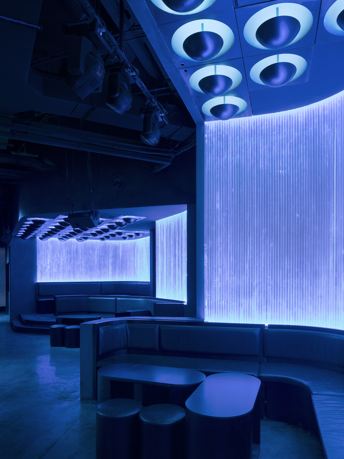 Subtle lighting casts a blue glow over Potent nightclub.