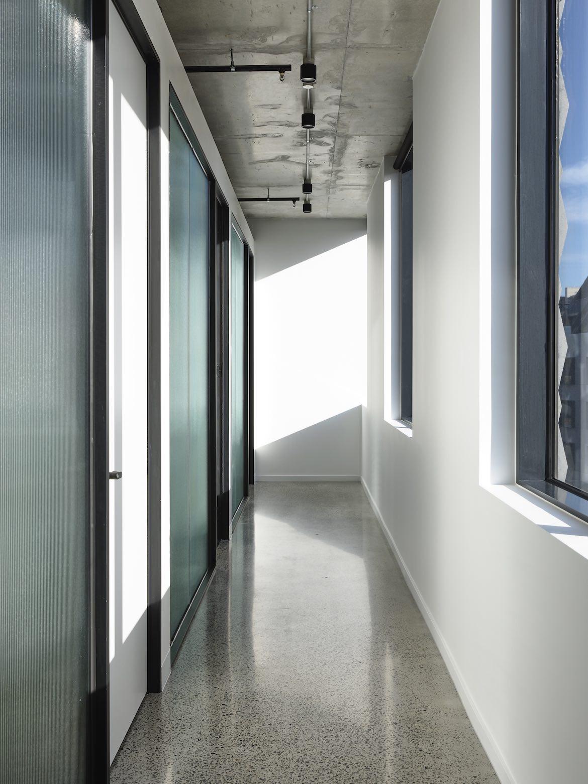 Long glass door hallway in the McCluskey Studio and SJB designed medical practice.