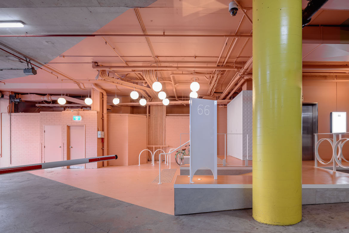 A grey and peach industrial carpark interior with a yellow poly at 66 Wentworth Ave.