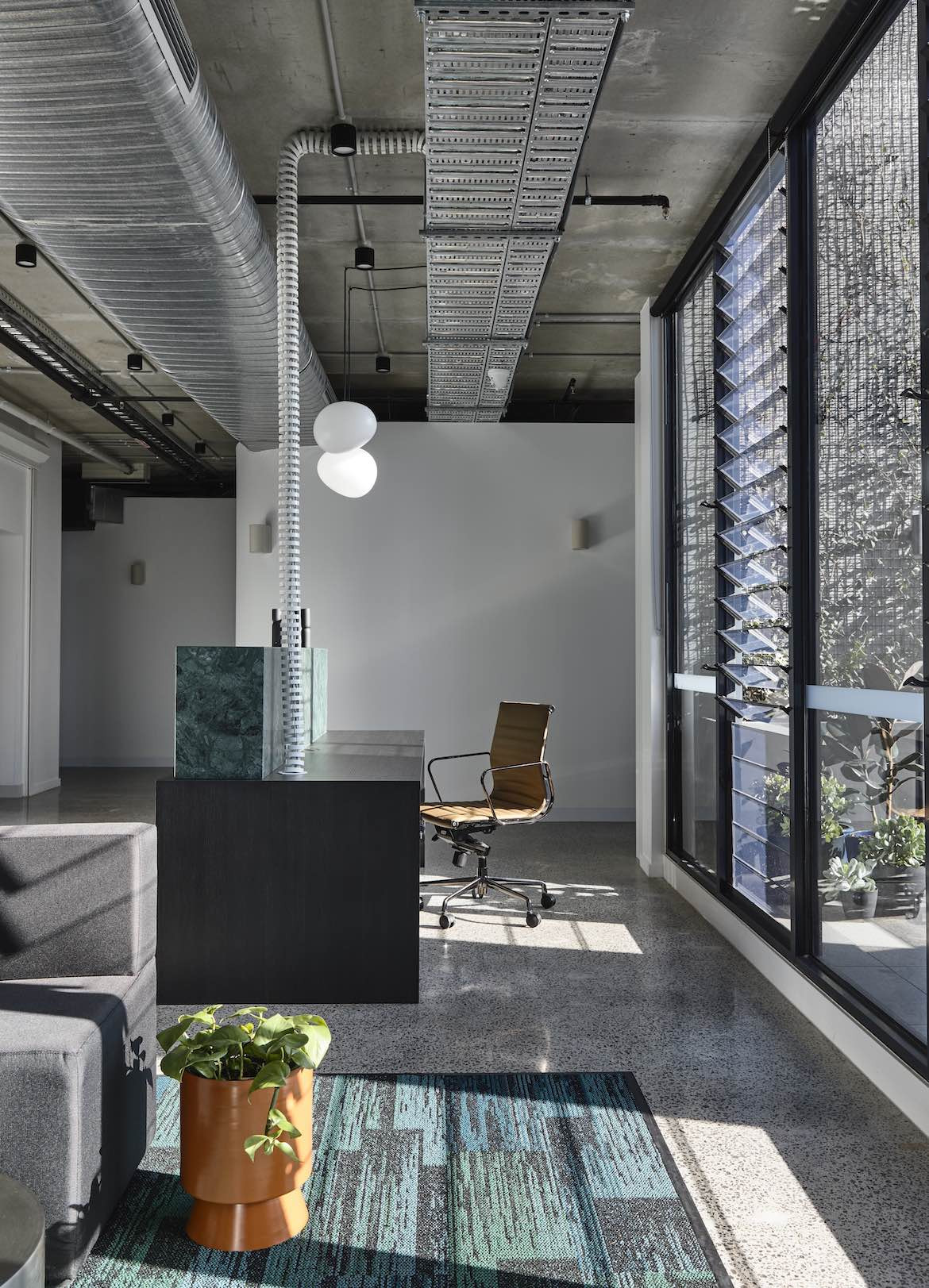 Exposed industrial ceilings in the McCluskey Studio and SJB designed medical practice.