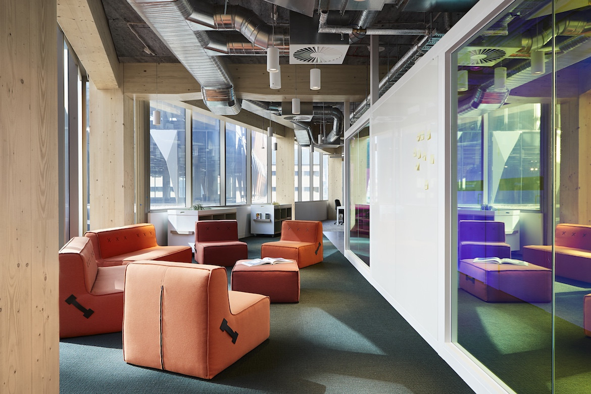 Orange re-arrangeable seating in the Architectus' Melbourne Entrepreneurial Centre office