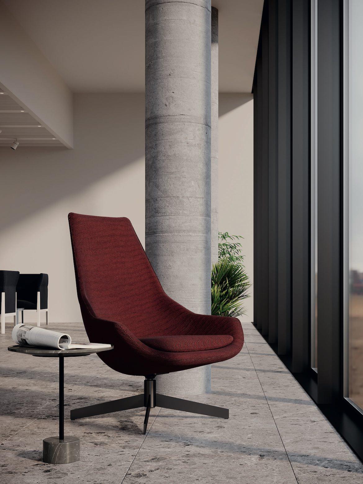 A red armchair by Jeffrey Bernett sits in an airport environment, Milan Design Week.