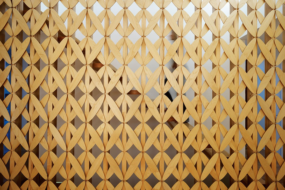 Elliptical timber screen, designed by Caroline Casey.