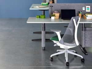 Ergonomic grey chair and desk essentials