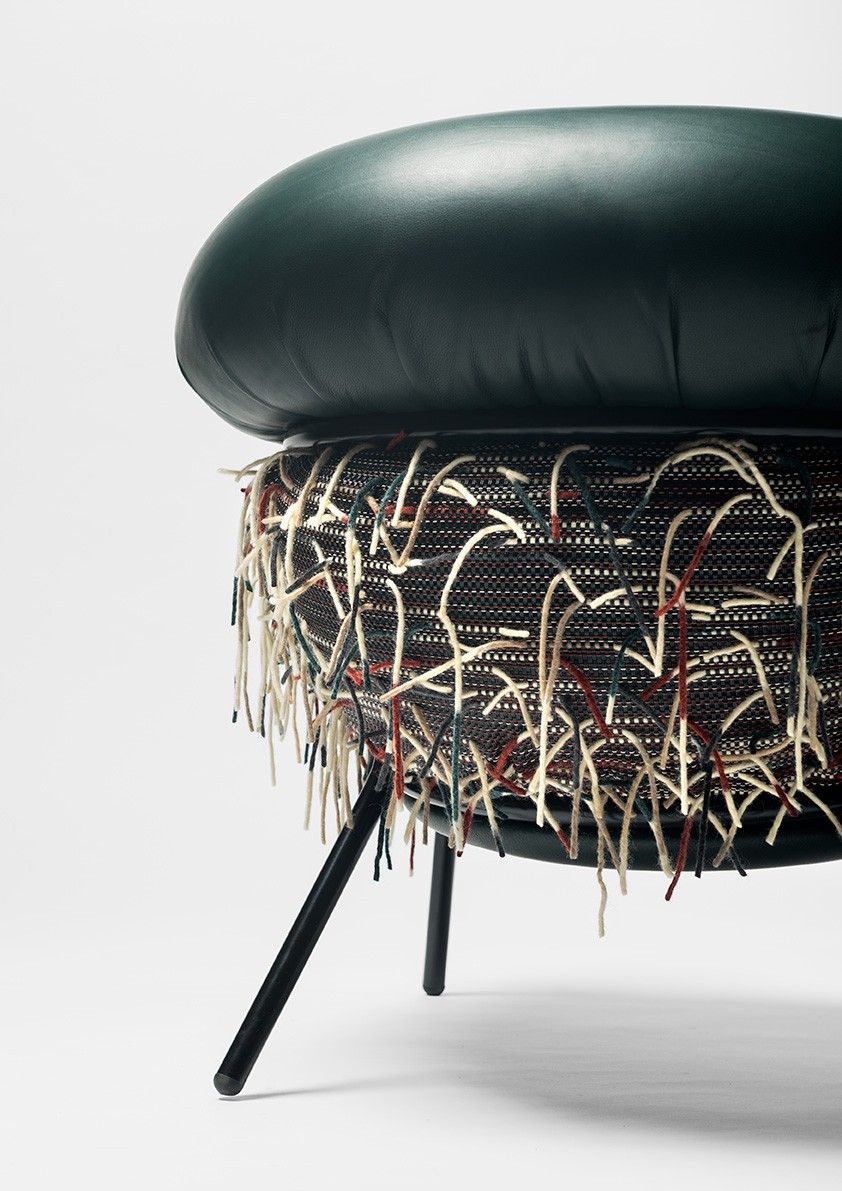 Detail of the Grasso chair, designed by Stephen Burks and featuring Bolon textiles.