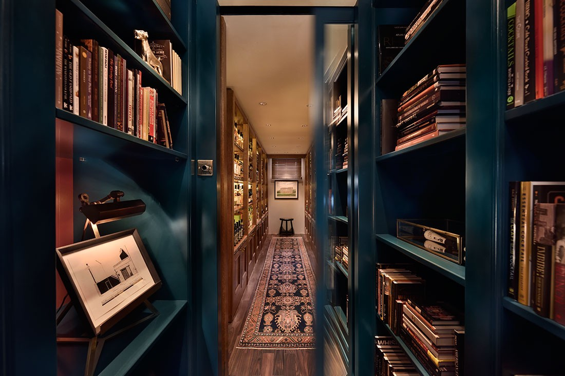 The apartment features a secret library.