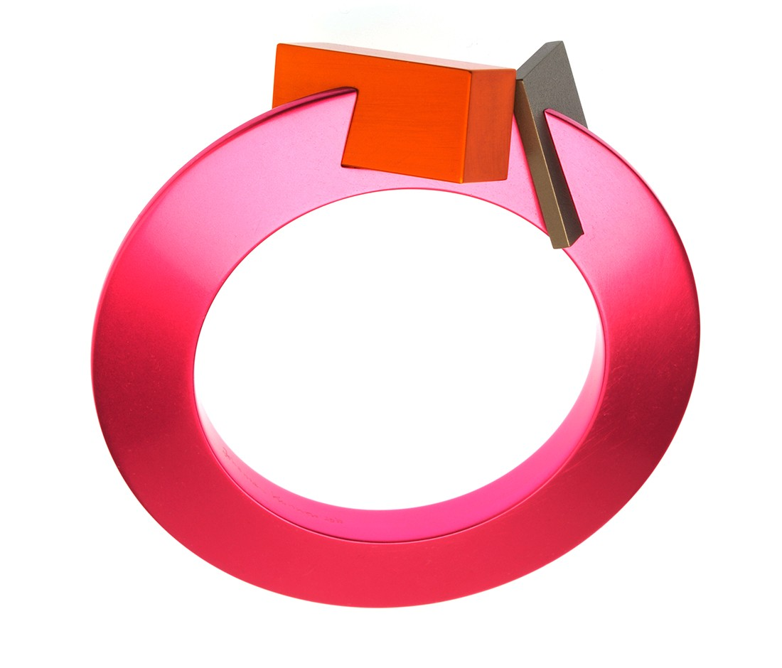 Johannes Kuhnen designed armring: anodised aluminium, titanium, 2010. Private collections Australia.