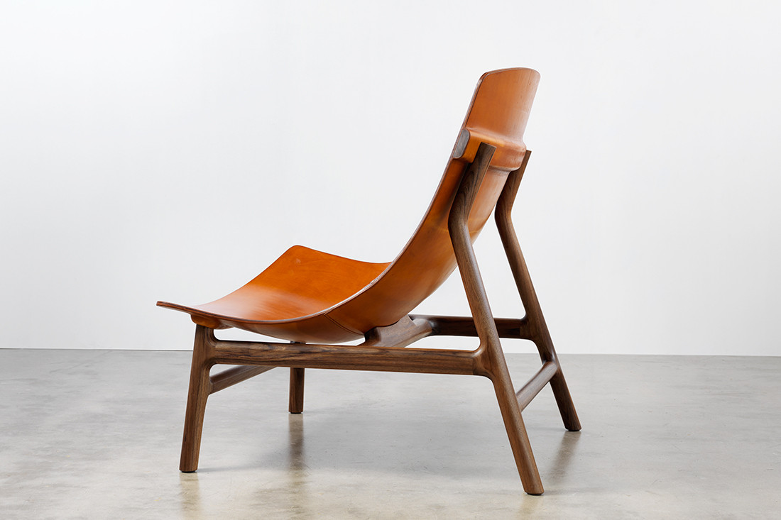 Settlers Chair by Jon Goulder features waterformed leather.