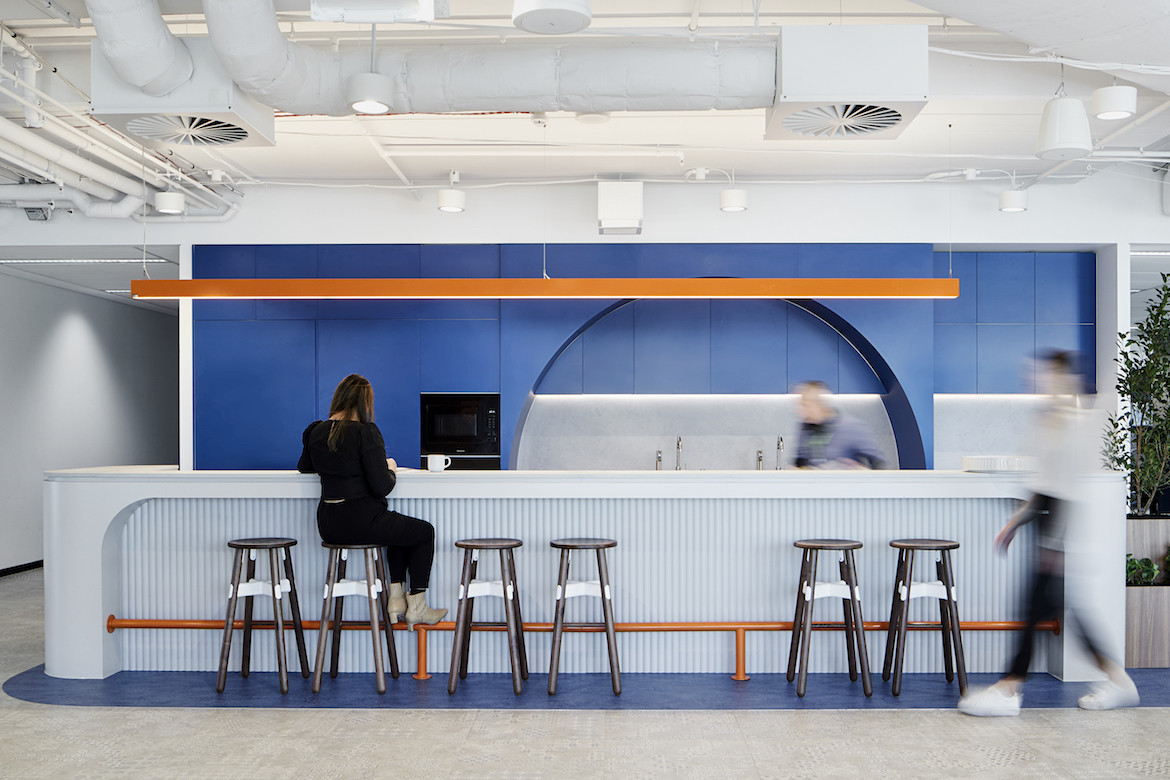 A bar in the blue, white and orange kitchen of IDP Education's melbourne office