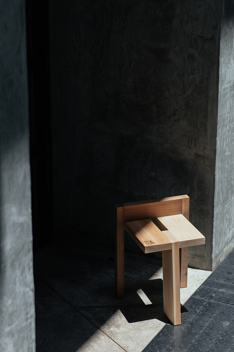 Tripodal Stool by Studio Adjective.