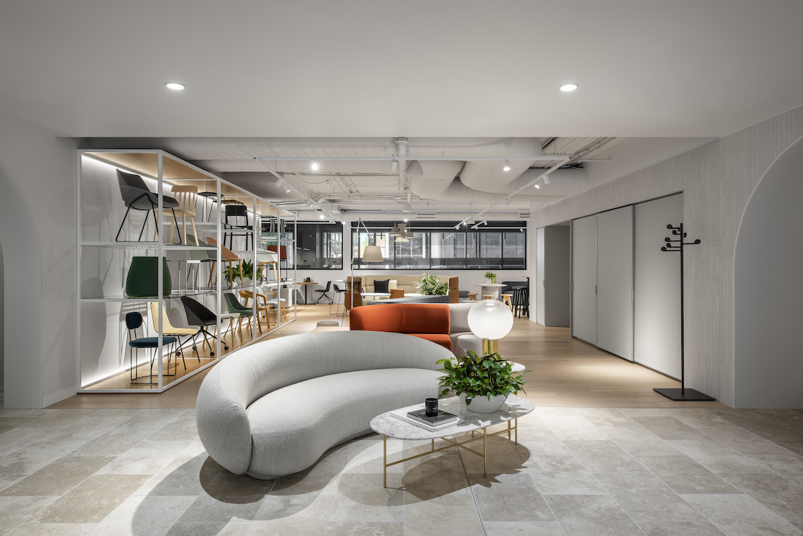 A white Tacchini Julep Sofa sits in the centre of the Stylecraft showroom.