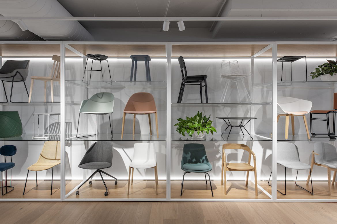 A custom built wall holds a range of chairs.