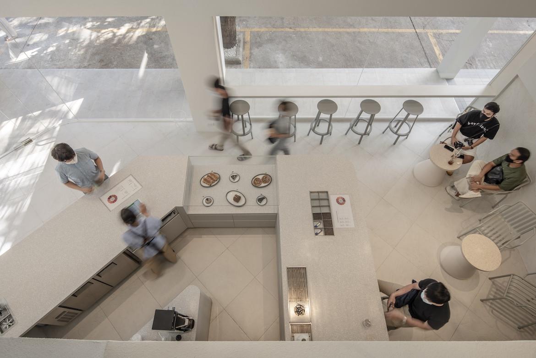 A birds-eye-view of the white Exterior of PAGA Microroastery cafe.