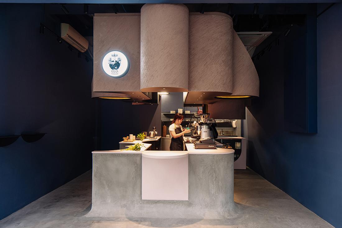 Studio SKLIM carves a café out of concrete in Singapore