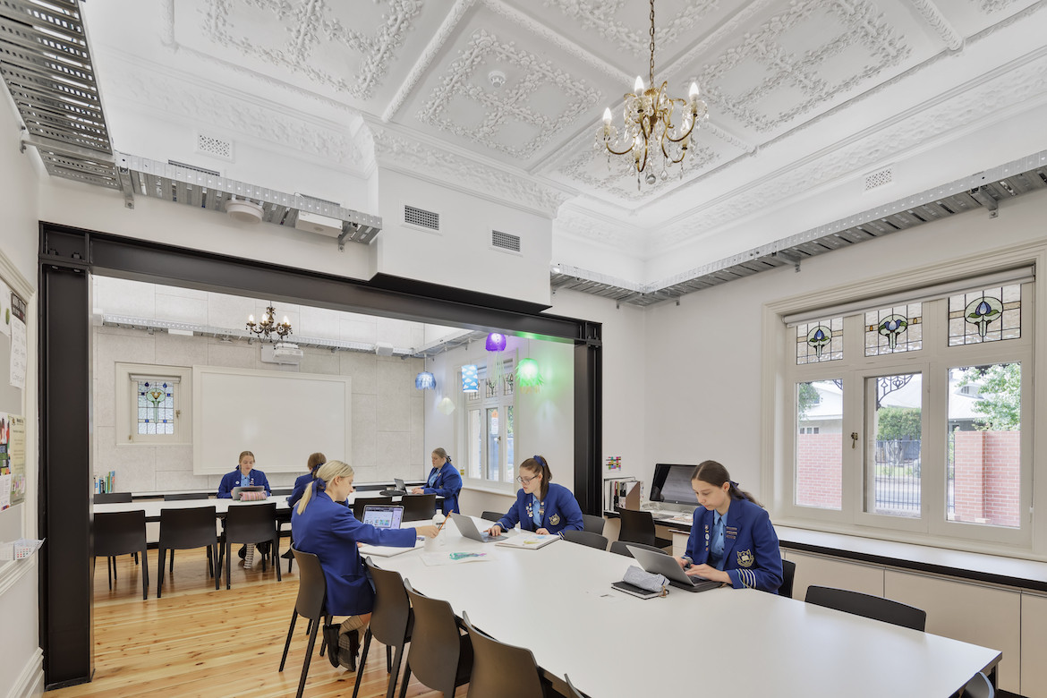 Historic white interiors of Walford Anglican School for Girls design and technology room by Matthews Architects