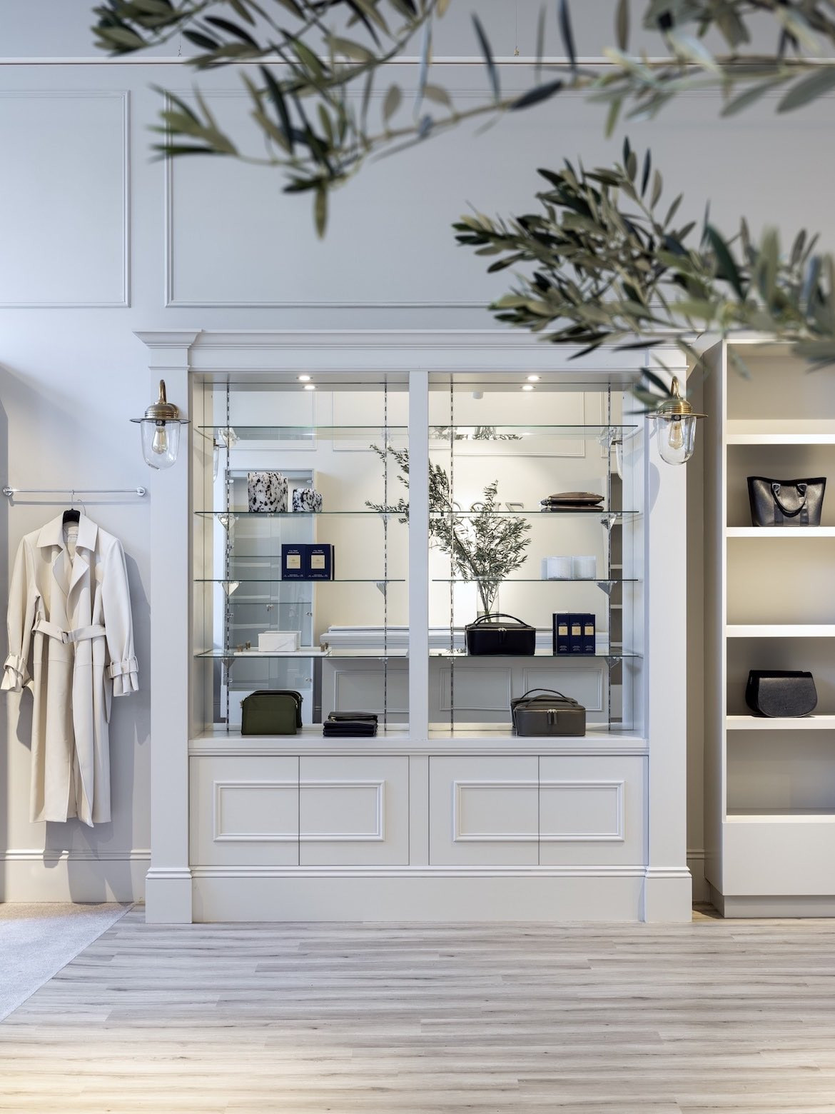 Shelving with a mirrored background display Zjoosh products.