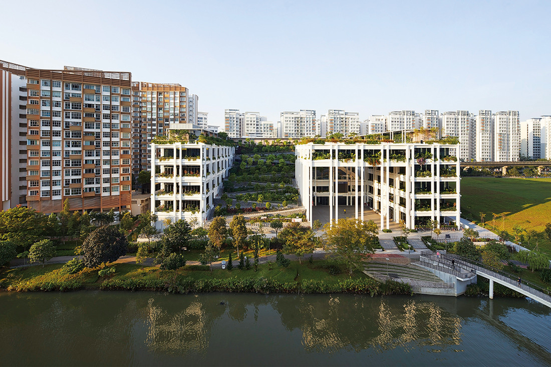 """Without a typological precedent for a neighbourhood centre that brings together a polyclinic, shopping and other communal facilities, Oasis Terrace references the """"common architecture"""" of HDB blocks. Photo by Hufton + Crow."""