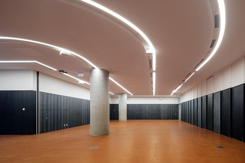Science Gallery Melbourne gallery with orange floor interior by Smart Design Studio.
