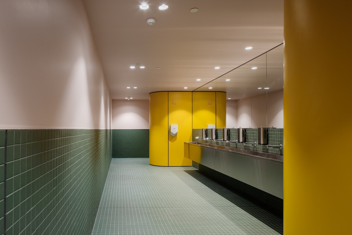 Science Gallery Melbourne yellow and green bathroom interior by Smart Design Studio.