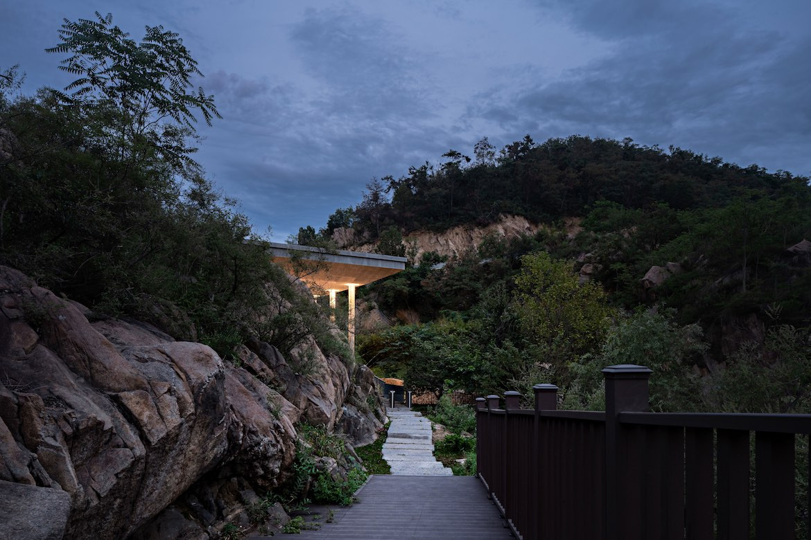 A winding pathway leads through rocks and trees to The Hometown Moon.